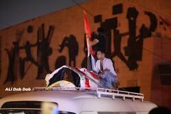 """صور.. """"التحرير"""" تشّيع """"السراي"""" بعد ان اخترقت قنبلة دخانية رأسه"""