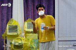 بالصور.. العراق يجلي أول مصاب بكورونا إلى بلده إيران