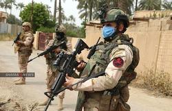 مسؤول لجنة اعدامات داعش بقبضة الامن العراقي (صورتان)