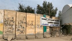 متظاهرون يغلقون مبنى محافظة الديوانية
