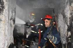 "With the participation of 10 firefighters teams ... a fire put out in an old ""Khan"" in central Baghdad"