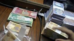 """الحكومة العراقية تطمئن الموظفين وتعلق على """"طبع العملة"""""""