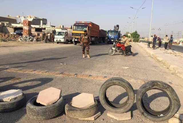 A blocked road in Diyala