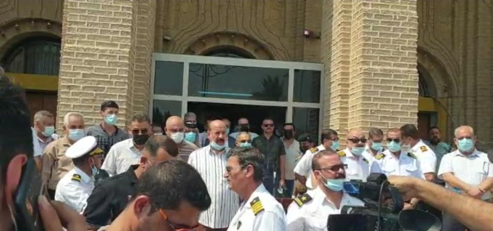 Iraqi ports employees protest against a minister's decision