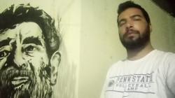 التحقيق مع ناشط رسم صدام حسين على جدار منزله