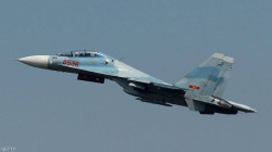 Russian Sukhoi Su-27 intercepts two American reconnaissance aircraft
