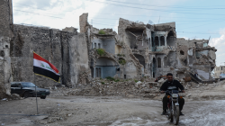 """الإطاحة بضابط """"مزيف"""" كان يجمع معاملات وأموال في الموصل"""