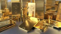 الذهب يهبط مع ارتفاع العائدات الأميركية والدولار
