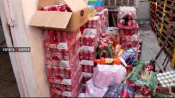 اتلاف أطنان من المواد الغذائية المهربة الى الموصل.. صور