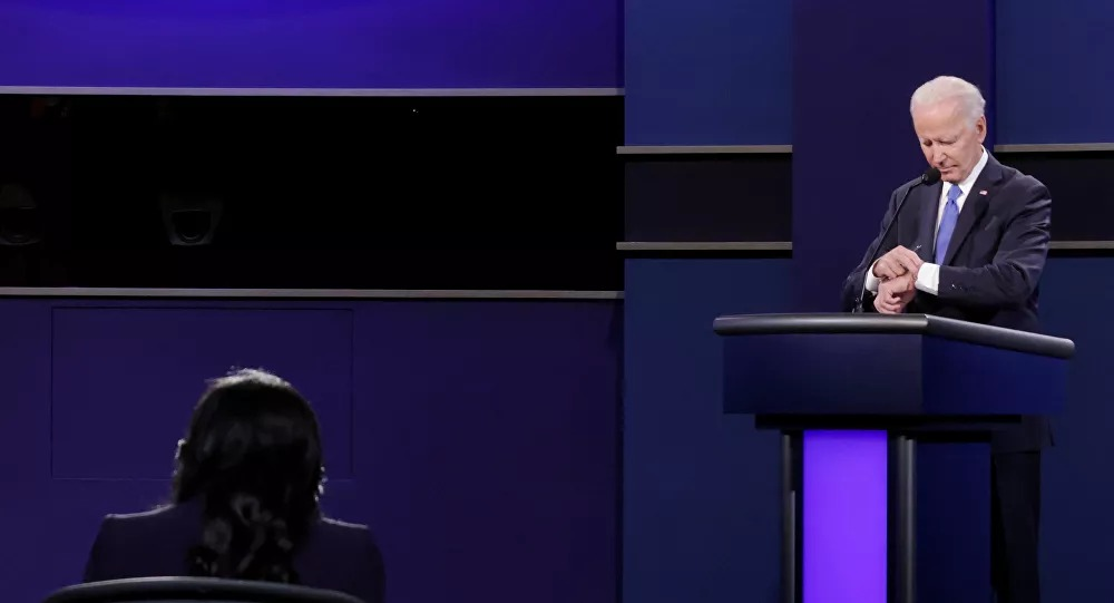 Biden checks watch to see how much time remains in debate