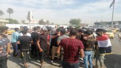 مصابون بإشتباكات بين محتجين وقوات امنية وسط بغداد