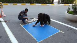 """صور.. منظمة تنشئ 25 """"موقفاً خاصاً"""" لسيارات ذوي الاحتياجات الخاصة بالسليمانية"""