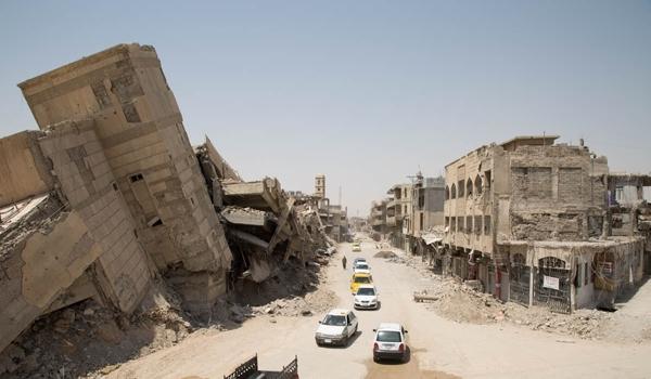 """إنتشال رفات من تحت أنقاض في الموصل واعتقال """"إرهابيين"""" هدما جسرا بكركوك"""