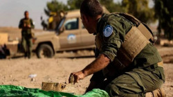The Asayish forces dismantle a mine in the countryside of Deir Ezzor