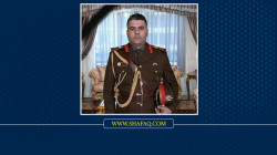 Iraqi authorities mourn a high-ranking officer killed in an explosion today