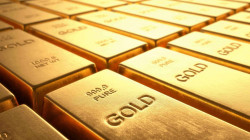 Gold inches higher as U.S. dollar eases off one-month peak