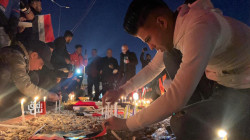 Kirkuk activists light candles honoring the victims of Baghdad explosions