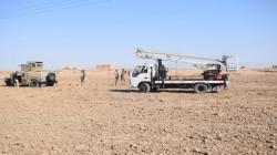 Iraqi army protecting maintenance teams repairing electric power towers northeast of Diyala