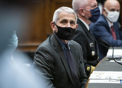 Americans might be wearing masks in 2022 to protect against Covid-19