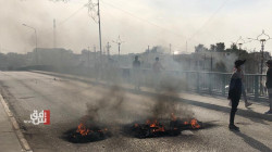 Demonstrators clash with the security forces in Dhi Qar