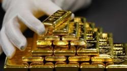 Gold yields as dollar slips
