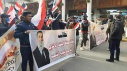 صور .. تظاهرة أمام البنك المركزي وسط بغداد تطالب بإعادة الدولار لسعره السابق