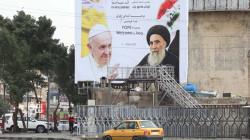 """صور.. عشية الزيارة المرتقبة.. بغداد تتزين بصور """"الحبر الأعظم"""" وسط إجراءات مشددة"""