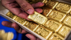 PRECIOUS-Gold recovers from 9-month low on U.S. stimulus cheer