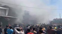 صور.. إخماد حريق كبير في سوق جنوبي بغداد