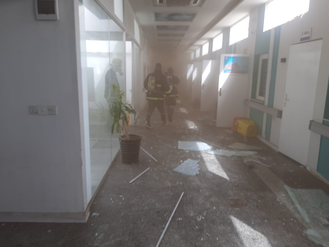 Civil Defense teams extinguish a fire that broke out in a hospital in Najaf