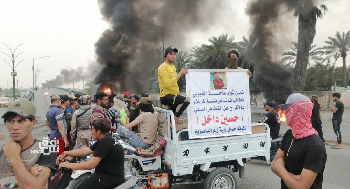 Angry demonstrators block a bridge in Nasiriya, demand the release of an activist