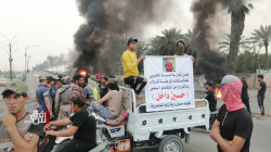 Angry demonstrators block a bridge in Nasiriya, demand the release of an activist