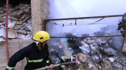 The Civil Defense teams extinguish a fire that broke out in Samarra Tax Department