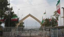 Iraqi protesters block a road leading to a border crossing with Iran