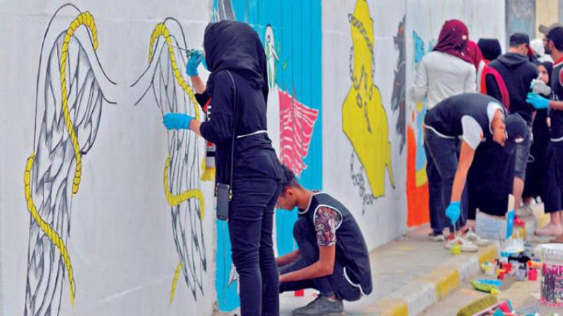 نسخة عراقية من أيقونة أميركية تزين جدران التحرير