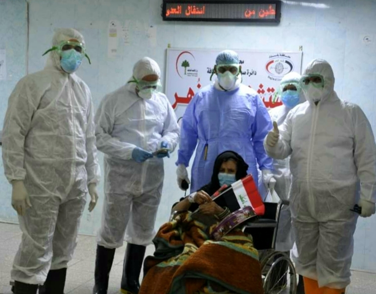 An elderly woman suffer from chronic diseases recovers from Corona in Baghdad