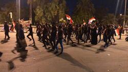 القوات الامنية تفرق متظاهرين عبروا من التحرير الى المنطقة الخضراء
