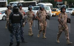 A number of security personnel injured in an attack targeting them near the central bank in Baghdad