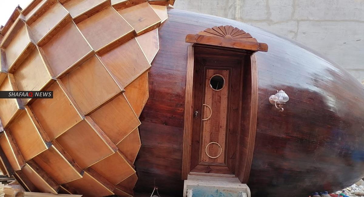 تحفة فنية.. تشكيلي كوردي يشيّد منزلاً على شكل ثمرة بلوط (صور)