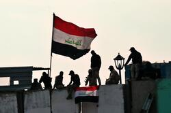 "Iraq recalls ""victory"" over ISIS amid bloody protests"