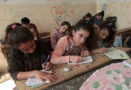 Factbox - From Kobani to Kirkuk: the Kurdish struggle for rights and land