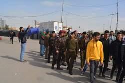 صور .. محتجون يغلقون كليتين في الناصرية والأمن ينتشر بساحة التظاهر بالنجف