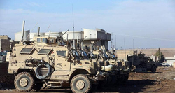 U.S. military trucks enter Iraq from northern Syria
