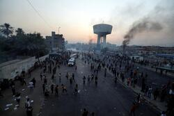 رصد مصور للاحتجاجات الدامية في بغداد مساء الخميس