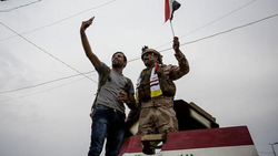 Streets closed in Baghdad, demonstrators allow security forces to approach them
