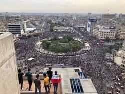 الامن يواجه المحتجين بالرصاص الحي وسط بغداد وانباء عن سقوط قتيل