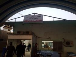 متظاهرون يستبدلون اسم مستشفى الحكيم بالنجف