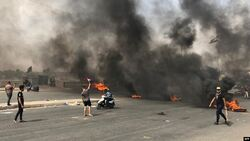 Protesters block roads leading to the center of an Iraqi province