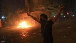 """قتلى وجرحى بصدامات و""""عنف مفرط"""" باحتجاجات محافظتين عراقيتين"""