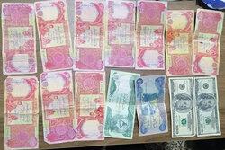 اعتقال عصابة من اسرة واحدة بحوزتهم اموالا مزيفة دولار ودينار بإقليم كوردستان